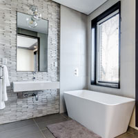 soaking tub with a feature stone wall