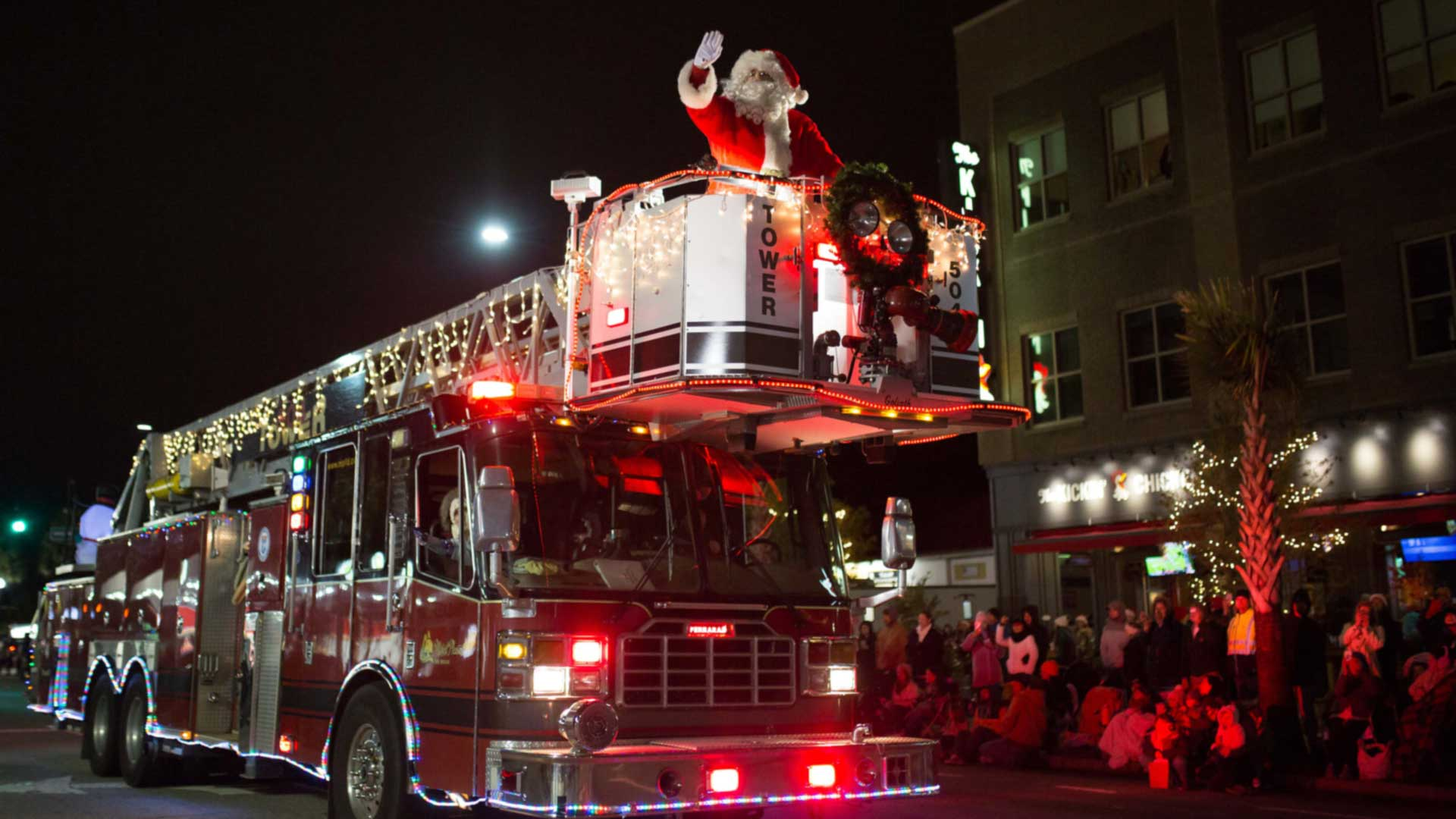 Santa rides high on the town of Mt. Pleasant Fire engine
